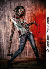 thriller - Scary bloody zombie girl with an ax. Halloween.