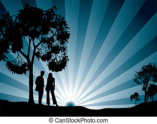 A couple watching the sun rise surrounded by tree