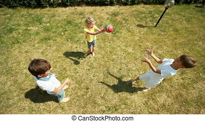 Throw and catch - The above-view of cheerful children...