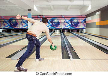 Throw - Young man playing bowling