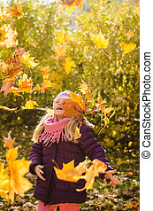 throwing autumn leaves