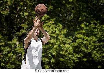 throwing basketball ball