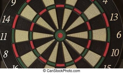 Playing darts hitting target on game board