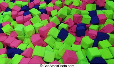 throwing green cube into pit in amusement center - throwing...