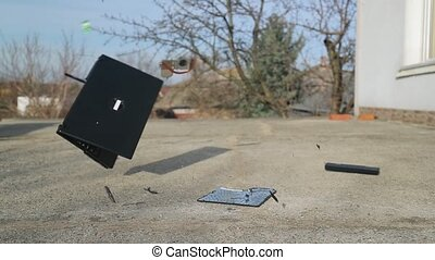 Throwing laptop on the ground - Smashing a laptop on...