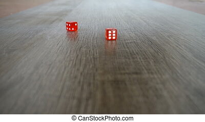 Throwing red dice on a grey background in the casino.