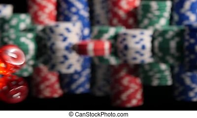Throwing red dice on the background of poker chips. Slow motion.