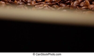 Throwing roasted coffee beans on pan, super slow motion shot...