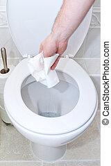 throwing toilet tissue down into the toilet