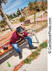 Throwing up - Guy throwing up on a park bench while taking a...