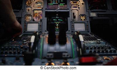 Thrust levers of a twin engined airliner. Thrust levers on...