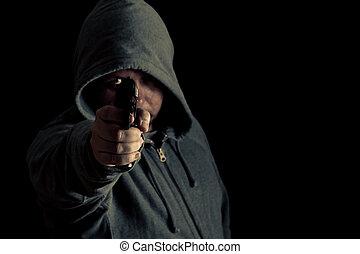Thug in hoodie points gun - Man in green hoodie points gun