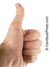 Thumb Bandage - A bandage on the thumb. Isolated on white...