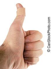 Thumb Bandage - A bandage on the thumb. Isolated on white...