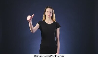 Thumb down beautiful young woman negative expression.
