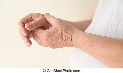 thumb pain - a man suffering from pain in his thumb