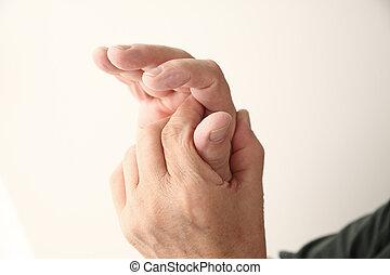 thumb pain in senior man