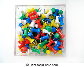 Thumb Tack Cube - Overhead shot on a bunch of multi-colored...