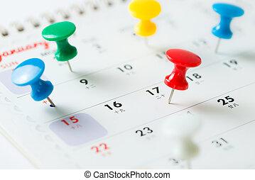 Thumb tack pin on calendar - Various color thumb tack pins...