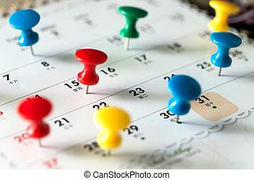Thumb tack pins on calendar as reminder - Various color...
