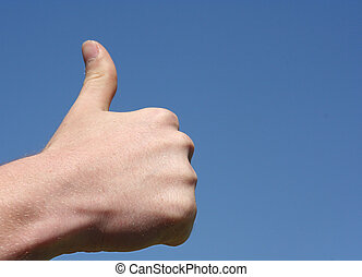 Thumb up against blue sky