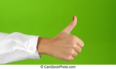 Thumb up and then thumb down. Woman hand, sign language -...