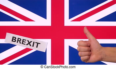 Thumb up for Brexit word and United Kingdom flag, approval...