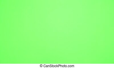 Thumb up, Like, OK, good sign chroma key. Man's hand closeup isolated at green screen background
