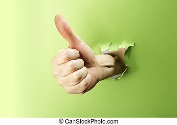Thumb up! - Man making thumb up gesture trough green paper.
