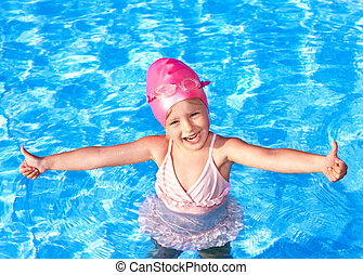 Thumb up of kid in swimming pool.