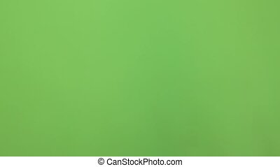 Thumb up, OK, good sign chroma key. Man's hand closeup isolated at green screen background