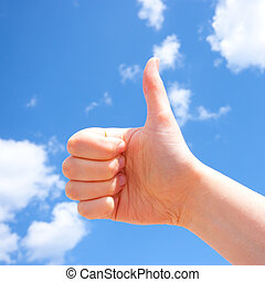 Thumb up over blue sky