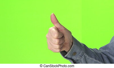 Woman's hand gestures thumbs up and down on green screen