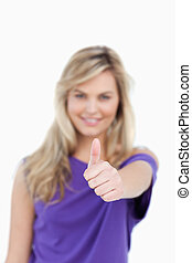 Thumbs up being placed by a blonde woman