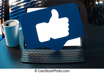Thumbs up blue symbols or icon on laptop with blank screen. 3d rendering.