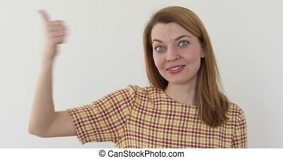 Thumbs Up By Woman, Indoor white background