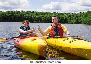 Thumbs up - Father and son enjoying kayaking