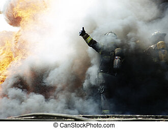 Thumbs-up - Fire Fighter giving thumbs-up through smoke
