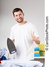 Thumbs up for man ironing