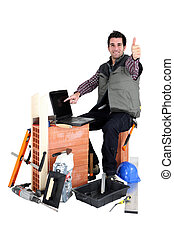 Thumbs up from a bricklayer with a laptop