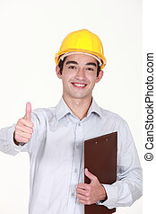 Thumbs up from a builder with a clipboard