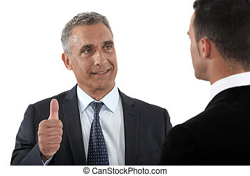 Thumbs up from a businessman