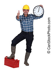 Thumbs up from a construction worker with a clock