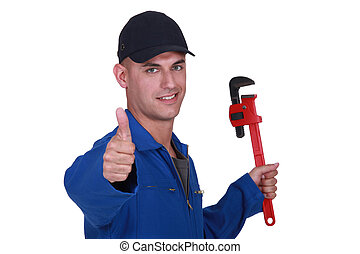 Thumbs up from a man with a wrench