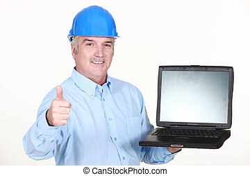 Thumbs up from an engineer with a laptop
