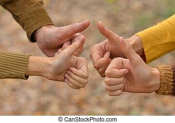Thumbs up gesturing