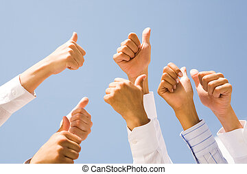 Thumbs up - Image of several human hands showing thumbs up...