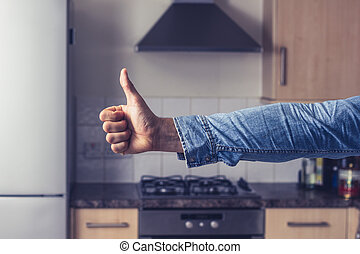Thumbs up in clean and tidy kitchen