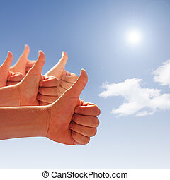 thumbs up on background of blue sky and white clouds - men's...