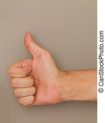 Thumbs up on wall background